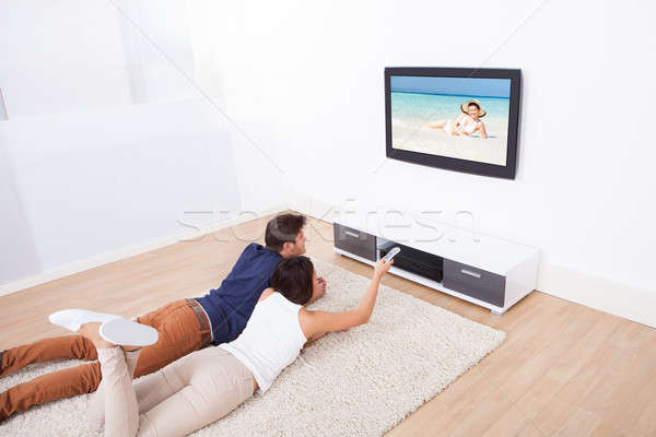 Couple Watching TV At Home Stock photo © AndreyPopov