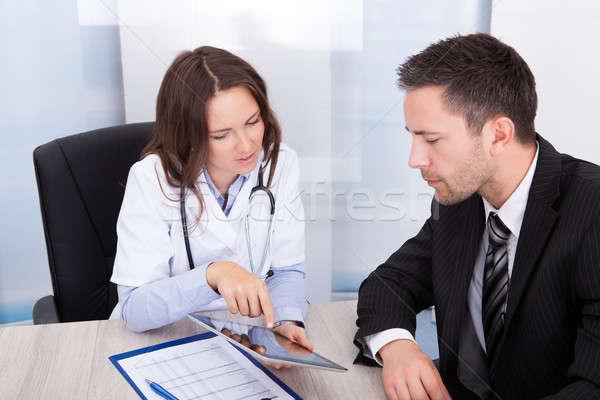 Female Doctor Showing Digital Tablet Stock photo © AndreyPopov