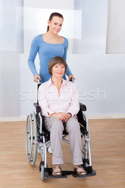 Caregiver With Disabled Senior Woman In Wheelchair Stock photo © AndreyPopov