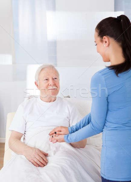 Gondozó idős férfi fiatal női öregek otthona Stock fotó © AndreyPopov