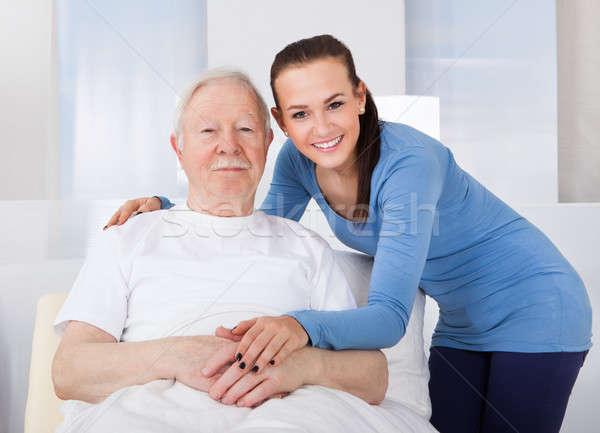 Caregiver Consoling Senior Man Stock photo © AndreyPopov