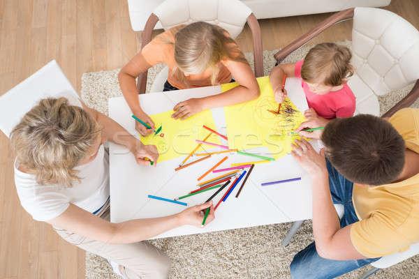 Giovani famiglia disegno insieme ragazzi home Foto d'archivio © AndreyPopov