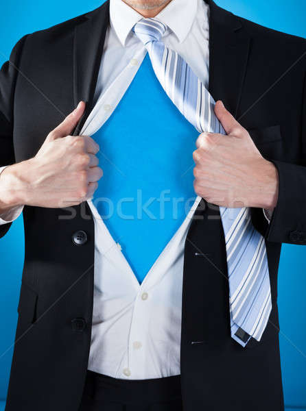 Superhero Businessman Tearing Suit Stock photo © AndreyPopov