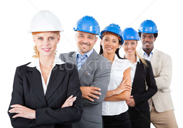 Architects Wearing Hardhats While Standing Arms Crossed Stock photo © AndreyPopov