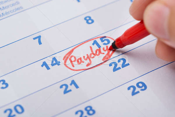 Hand Marking Payday On Calendar Stock photo © AndreyPopov
