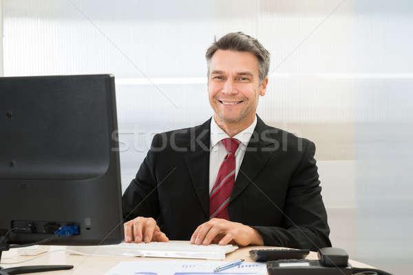 Happy Mature Businessman Stock photo © AndreyPopov