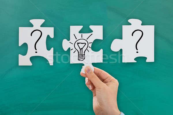 человек стороны лампа вопросительный знак головоломки Сток-фото © AndreyPopov