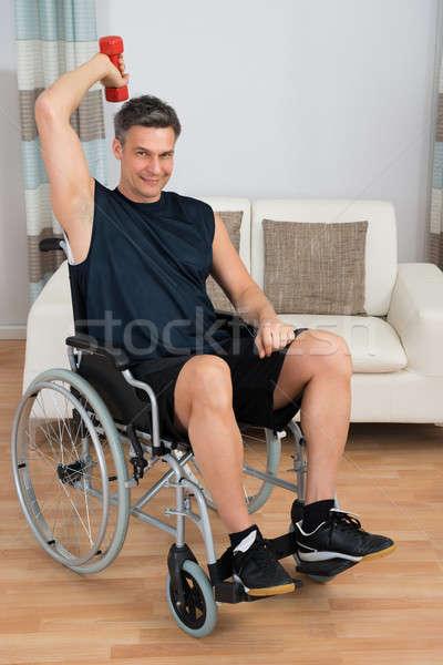 Zdjęcia stock: Upośledzony · człowiek · wózek · domu