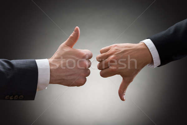 Businesspeople Hands Showing Thumb Up And Thumb Down Stock photo © AndreyPopov