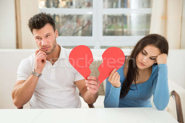 Sad Couple Holding Broken Heart Stock photo © AndreyPopov