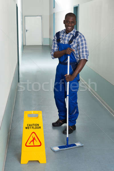 Male Janitor Mopping In Corridor Stock photo © AndreyPopov