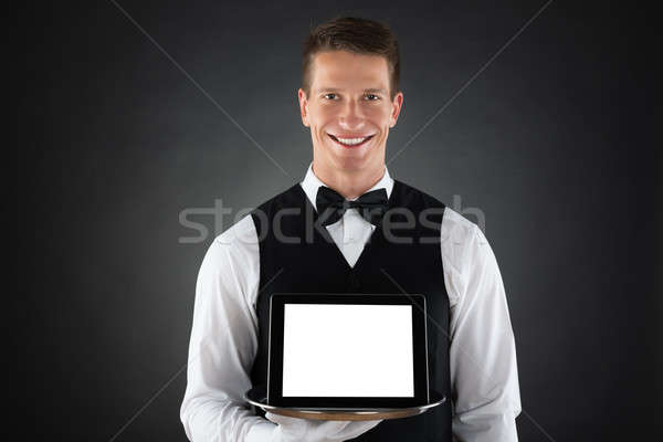 Butler Holding Tray With Digital Tablet Stock photo © AndreyPopov