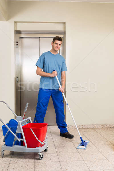 Male Janitor Mopping Floor Stock photo © AndreyPopov