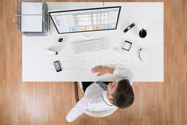 Young Businessman Suffering From Backache Stock photo © AndreyPopov
