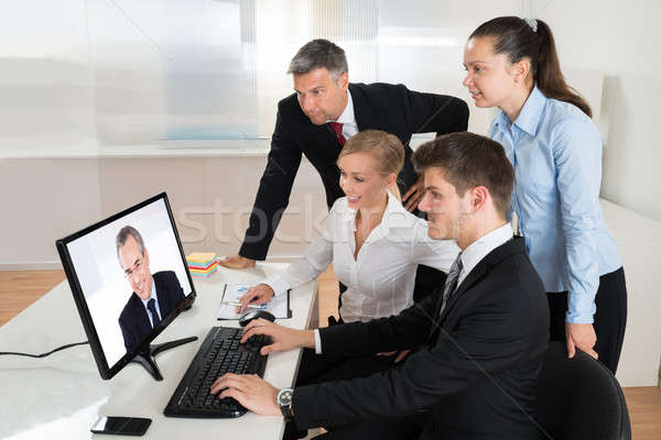Businesspeople Videoconferencing On Computer Stock photo © AndreyPopov