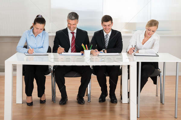Businesspeople Writing On Clipboard Stock photo © AndreyPopov
