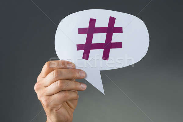 Hand Showing Hashtag On Speech Bubble Stock photo © AndreyPopov