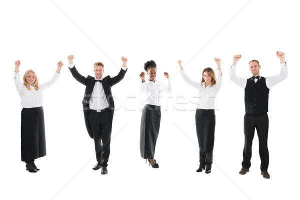 Happy Waiter And Waitresses Standing With Arms Raised Stock photo © AndreyPopov