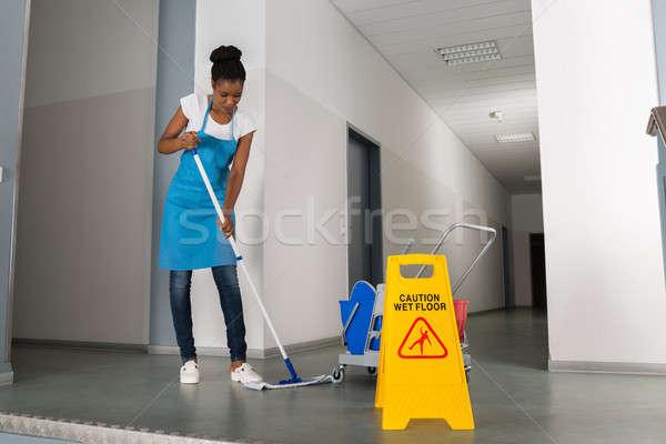 Woman Mopping Corridor Stock photo © AndreyPopov