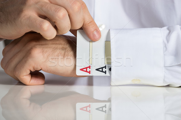 Businessman Removing Ace Cards From Sleeve Stock photo © AndreyPopov