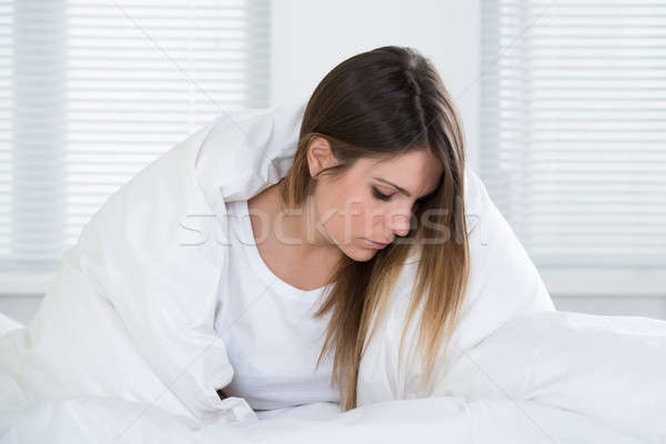 Young Woman Covered With Blanket Stock photo © AndreyPopov