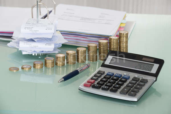 Receipts With Calculator And Money On Desk Stock photo © AndreyPopov
