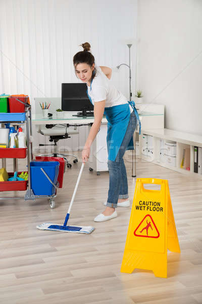 Female Janitor Mopping Wooden Floor Stock photo © AndreyPopov