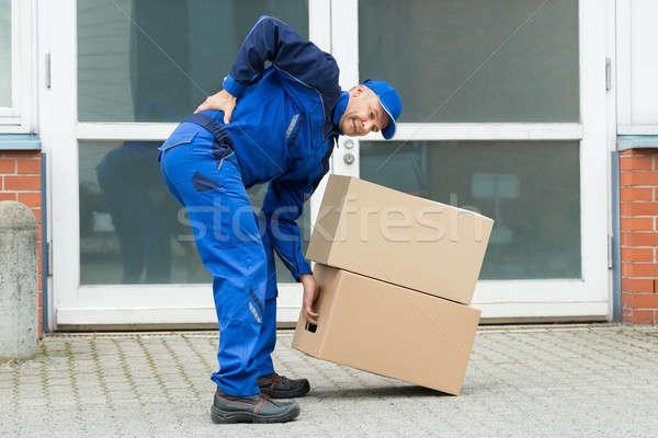 Mensajero sufrimiento cajas hombre pared Foto stock © AndreyPopov