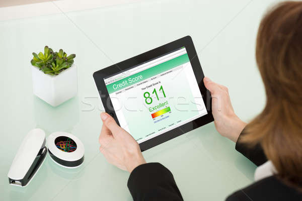 Businesswoman Hand With Digital Tablet Showing Credit Score Stock photo © AndreyPopov