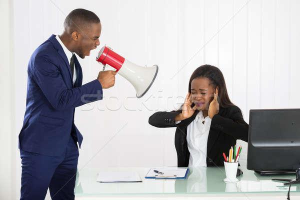 Jefe jóvenes mujer de negocios altavoz oficina Foto stock © AndreyPopov