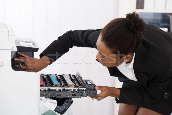 Businesswoman Fixing Photocopy Machine Stock photo © AndreyPopov