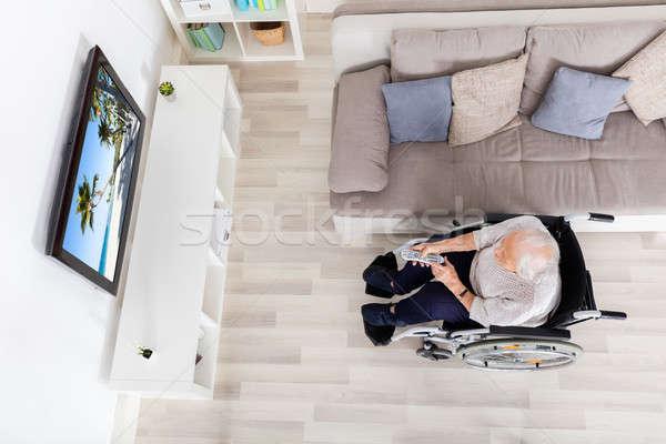 Idősebb nő néz film televízió magasról fotózva Stock fotó © AndreyPopov