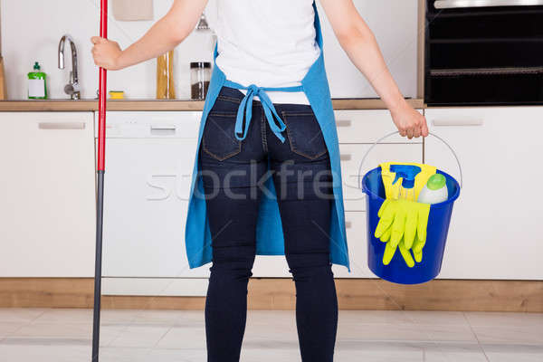 Close-up Of Housemaid Standing In Kitchen Stock photo © AndreyPopov