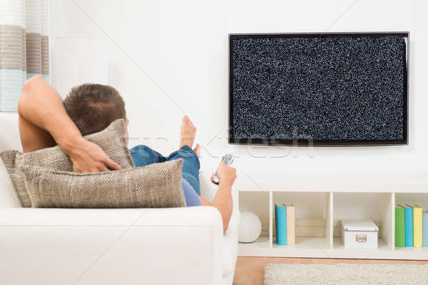 Man With Remote Control Watching Television Stock photo © AndreyPopov