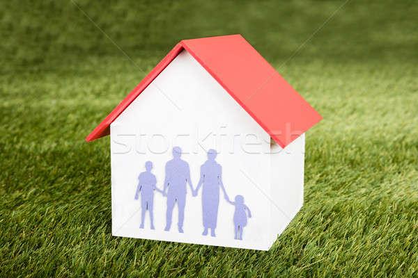 Ház modell család közelkép füves mező Stock fotó © AndreyPopov