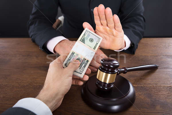 Judge Refusing To Take A Bribe From Client Stock photo © AndreyPopov