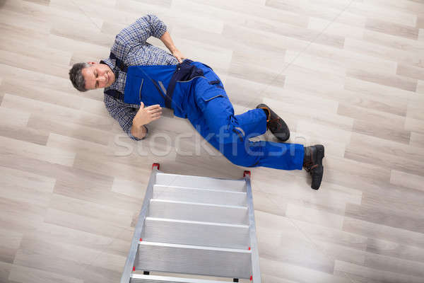 Stock photo: High Angle View Of A Repairman Fallen From Ladder