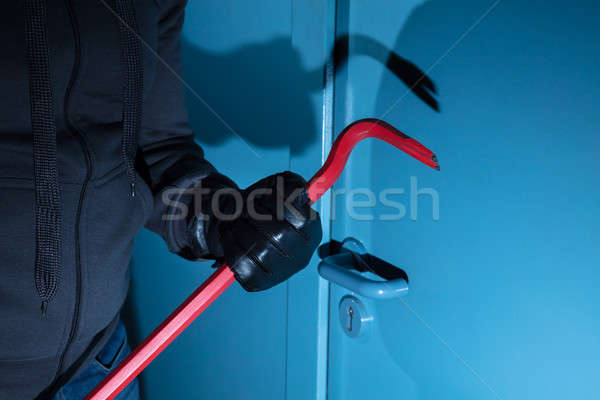 Burglar Holding A Crowbar Stock photo © AndreyPopov