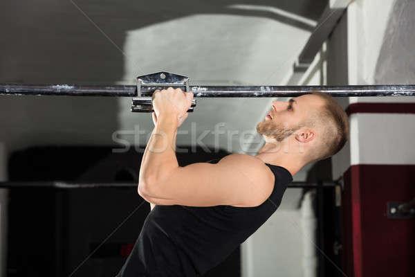 Athlète homme étroite exercice Photo stock © AndreyPopov