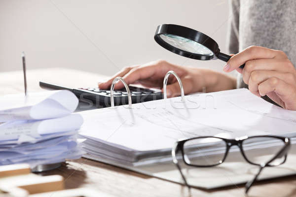 Businesswoman Examining The Documents Stock photo © AndreyPopov