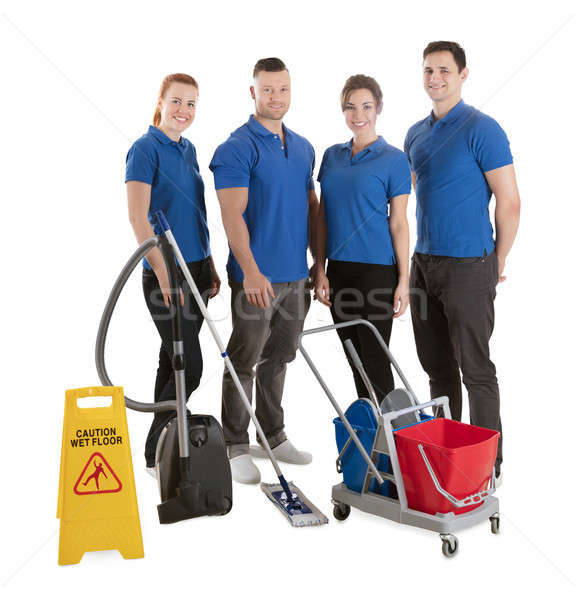 Portrait Of Happy Janitors With Cleaning Equipments Stock photo © AndreyPopov