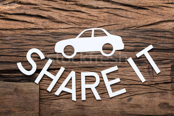 Paper Car And Share It Text On Wooden Table Stock photo © AndreyPopov