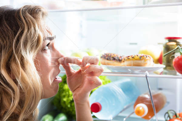 Young Woman Holding Her Nose Near Foul Food Stock photo © AndreyPopov