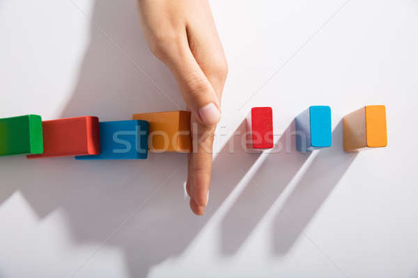 Businessperson Hand Stopping Colorful Blocks From Falling Stock photo © AndreyPopov