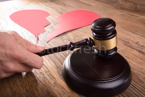 Divorce Judge With Broken Heart At Desk Hitting Gavel Stock photo © AndreyPopov