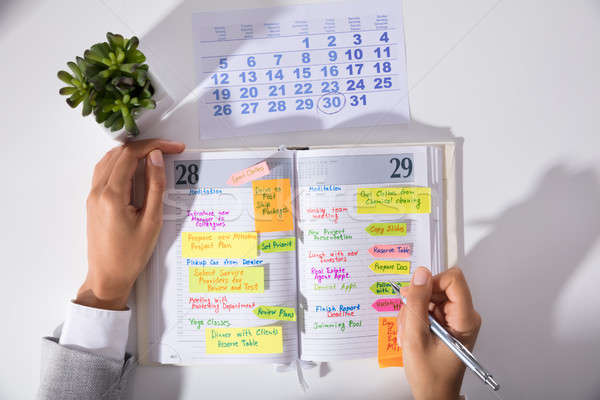 Businesswoman Hand's With Calendar Writing Schedule In Diary Stock photo © AndreyPopov