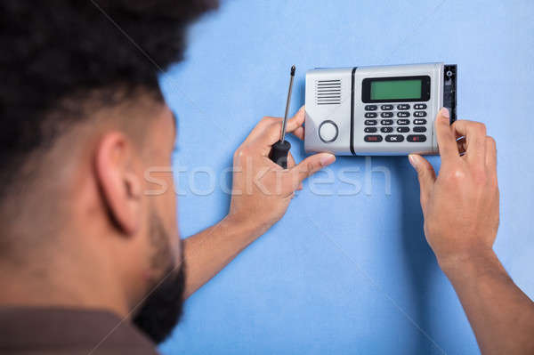 Man Installing Security System Stock photo © AndreyPopov