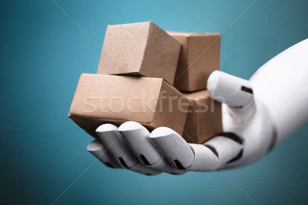 Robot Holding Cardboard Boxes Stock photo © AndreyPopov