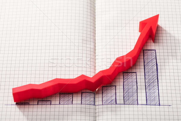 Red Arrow Over Increasing Graph On Notebook Stock photo © AndreyPopov