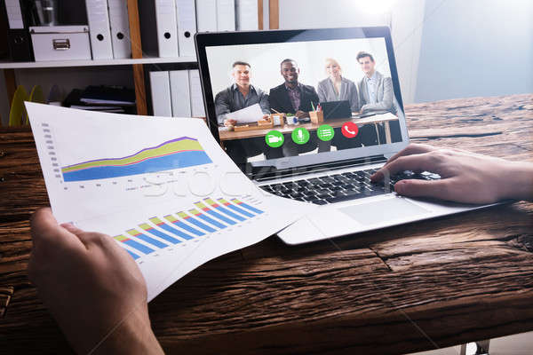 Businessperson Video Conferencing With Colleagues On Laptop Stock photo © AndreyPopov
